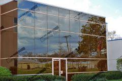 Film de protection solaire métallisé bronze  GLASS 208x. Luminis-Films