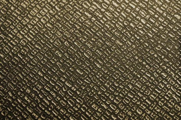 Revêtement décoratif effet cuir noir et or. Luminis Films