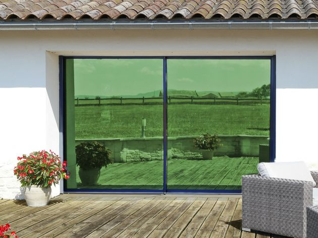 Film de protection solaire métallisé vert. Luminis Films