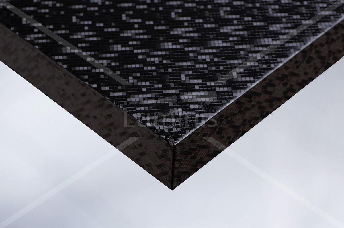 Revêtement mural multi facettes noir. Luminis-Films